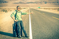 Young handsome man hitch-hiking in the Death Valley - California Royalty Free Stock Photos