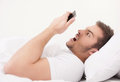 Young handsome man holding telephone dismayed male guy waking late Stock Photos