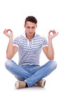 Young handsome man meditating Royalty Free Stock Photography