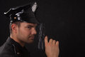 Young handsome policeman with gun a Royalty Free Stock Image