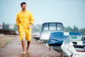 Young handsome sailor man walking at the sea pier Royalty Free Stock Photo