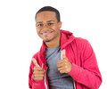 Young handsome teenager giving two thumbs up at the camera closeup portrait of smiling man in red hoody isolated on white Stock Photos