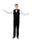 Young handsome waiter gesturing welcome