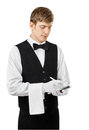 Young handsome waiter taking order Royalty Free Stock Photo