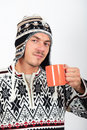 Young handsome winter man with cup of coffee Royalty Free Stock Photography