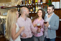 Young happy adults at bar casual meeting of smiling selective focus Stock Photos