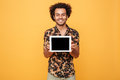 Young happy afro american man showing blank screen pc tablet