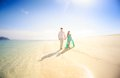 Young happy asian couple on honeymoon handsome men walk with beautiful blonde girlfriend in blue dress Stock Photo