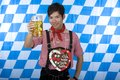 Young happy Asian man holds Oktoberfest beer stein Stock Photo