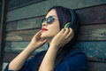 Young happy asian woman using headphone to listen to her music Royalty Free Stock Photo