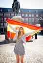 Young happy attractive exchange student girl having fun in town visiting madrid city showing spain flag outdoors Royalty Free Stock Images