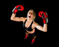 Young happy beautiful boxer girl with boxing gloves arms in victory sign with fit and healthy body Royalty Free Stock Photo