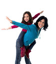 Young happy Brazilian mother carrying on her back  little daughter as airplane flying Royalty Free Stock Photo