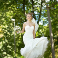 Young happy bride jumping summertime picture Royalty Free Stock Photography