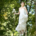 Young happy bride jumping summertime picture Stock Photography