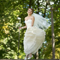 Young happy bride jumping summertime picture Stock Photo