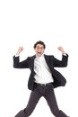 Young happy business man jumping in the air isolated on white with legs spread background Royalty Free Stock Photography