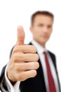 Young happy business man showing thumb s up sign portrait of approval good work and success Stock Photography