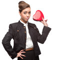 Young happy business woman on valentine s day holding red heart isolated white Royalty Free Stock Photo