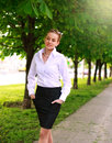 Young and happy business woman walking in city green park Royalty Free Stock Photo
