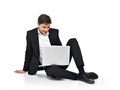 Young happy businessman working on laptop Stock Photo