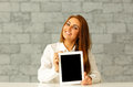 Young happy businesswoman showing tablet computer display Royalty Free Stock Photography