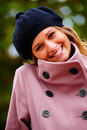 Young happy charming girl wearing a winter cap Stock Image