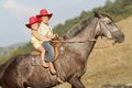 Young happy children riding horse Stock Photo