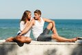 Young happy couple embracing on sea coast Royalty Free Stock Photography