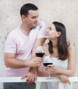 Young happy couple enjoying glasses red wine terrace Stock Photos