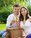 Young happy couple enjoying a glasses of white wine Royalty Free Stock Photo