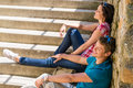 Young happy couple flirting on the stairs Stock Photography