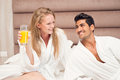 Young happy couple having breakfast in luxury hotel room Stock Image