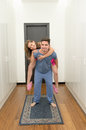 Young happy couple with her at piggyback on pijamas this image has attached release Royalty Free Stock Photos