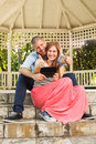 Young happy couple holding a thumbs up and tablet pc in hand Stock Photos