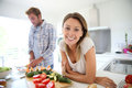Young happy couple in the kitchen preparing meal Royalty Free Stock Photo