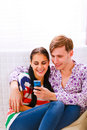 Young happy couple looking on cell phone Royalty Free Stock Photo