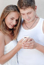 Young happy couple looking on mobile phone Stock Photo