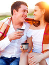 Young happy couple in love at the summer picnic outdoors portrait Stock Image