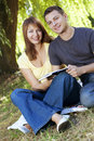 Young happy couple reading a book Royalty Free Stock Photography