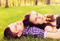 Young happy couple resting on the grass Stock Image