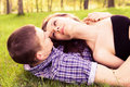 Young happy couple resting on the grass Royalty Free Stock Photography
