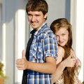 Young happy couple showing thumbs up Stock Images