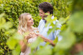 Young happy couple smiling at each other and toasting in the grape fields Royalty Free Stock Photo