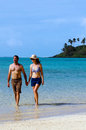 Young happy couple on vacation in pacific island attractive hold hands comes out of the water of muri beach lagoon rarotonga cook Royalty Free Stock Images