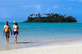 Young happy couple on vacation in pacific island attractive hold hands and walks muri beach lagoon rarotonga cook islands Stock Photo