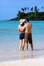 Young happy couple on vacation in pacific island attractive hugs and kisses muri beach lagoon rarotonga cook islands Royalty Free Stock Photos
