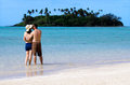 Young happy couple on vacation in pacific island attractive kisses muri beach lagoon rarotonga cook islands Stock Photography