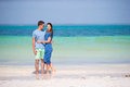 Young happy couple on white beach at summer vacation have fun during Royalty Free Stock Photo