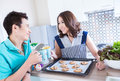 Young happy couples in domestic kitchen with breakfast selective focus at man Royalty Free Stock Photos